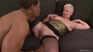 Mature short haired blonde DD gets cum on face from a black guy