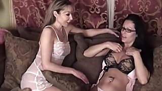 Mature lesbian MILF babes lick each others shaved pussies